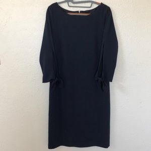 Alex Marie navy dress with arm cutouts